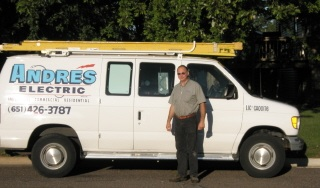 Andre Dupuis, Owner-Andre's Electric - Standing by his Van